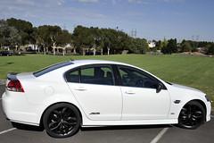 jaguar xf(0.0), sports car(0.0), automobile(1.0), automotive exterior(1.0), executive car(1.0), wheel(1.0), vehicle(1.0), automotive design(1.0), rim(1.0), full-size car(1.0), compact car(1.0), bumper(1.0), pontiac g8(1.0), sedan(1.0), land vehicle(1.0), luxury vehicle(1.0),