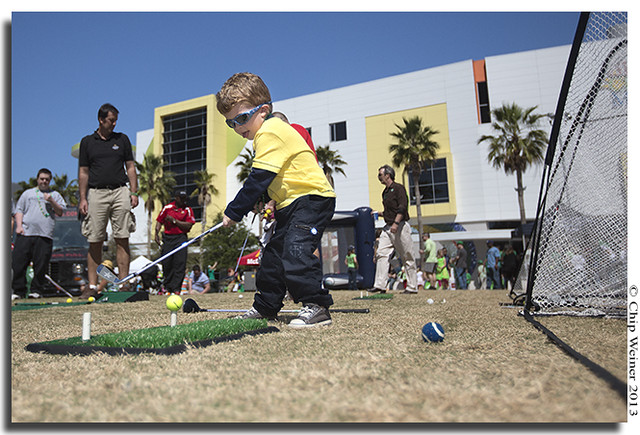 Three-year-old Aidan Ryan tries to improve his golf swing