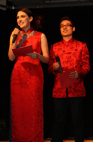 My Chinese husband, John, and I dressed in auspicious red silk to host our university's Chinese New Year celebration.