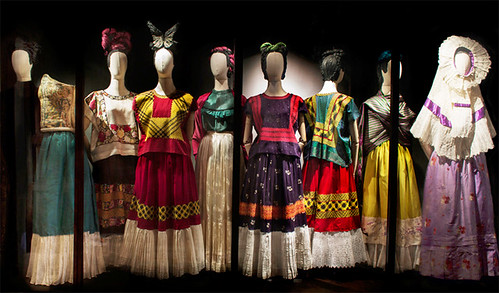 Eight faceless mannequins are dressed in clothing belonging to Frida Kahlo