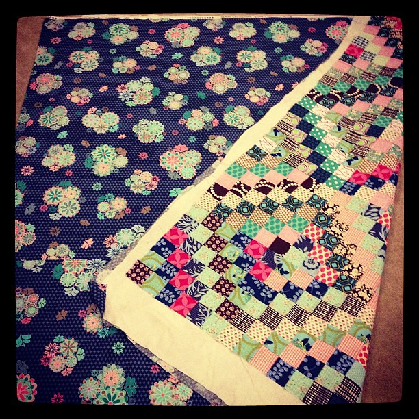 Quilt 4 of 5 basted! I started with the backing and used it as a palette for the front. #scrappytripalong