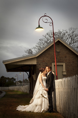 Bride and groom at a train station.