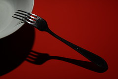 guitar(0.0), illustration(0.0), fork(1.0), tool(1.0), red(1.0), tableware(1.0), cutlery(1.0), black(1.0),