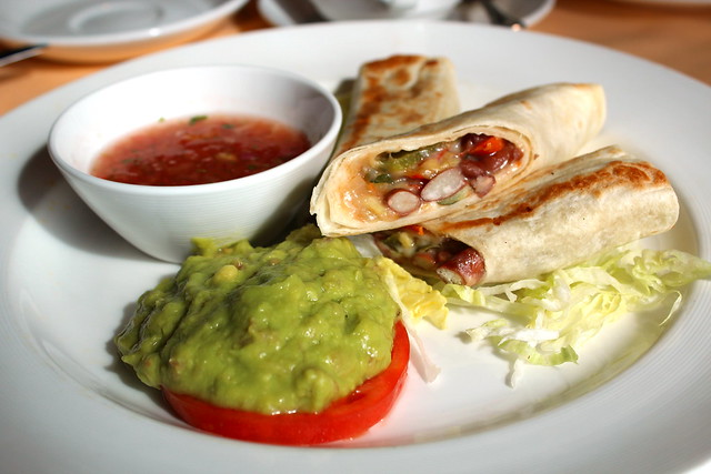 Vegetarian Burrito with char-broiled vegetables and red kidney beans, guacamole, Mexican salsa