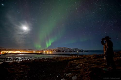 Aurora dancing in the moonlight