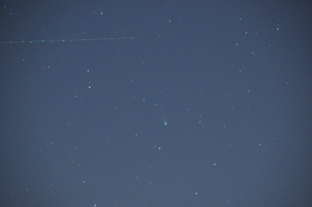 Comet C/2012 F6 Lemmon with passing aircraft
