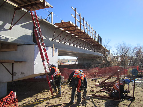 Photo of construction workers at First Creek commuter rail bridge