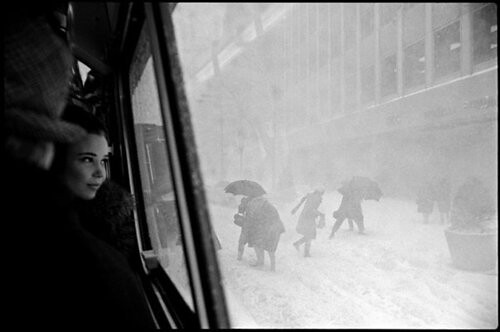 Hartmann, Erich (1922-1999) - 1967 Girl Looks Out Bus Window at Snowstorm, New York