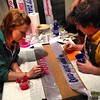 Damon and Amanda from New Bohemia signs painting the excellent sashes for Southern Exposure's auction!