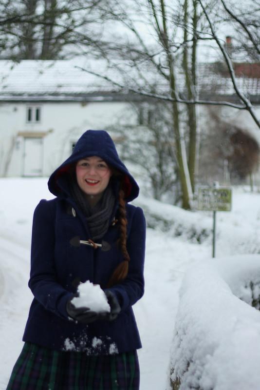 Snow - duffle coat, tartan skirt, wellies