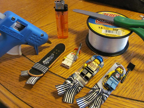 View of 2 completed and 1 in progress Lego Tech Deck skateboard boutonniere with supplies