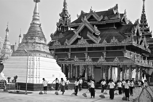 It's disrespectful to wear shoes in the pagodas, but there are dozens and dozens who ensure the thousands and thousands of visitors each day feel their feet are clean