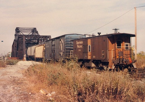 A Southern Pacific bay window caboose passing through Nerska Junction.  Chicago Illinois.  Early November 1989. by Eddie from Chicago