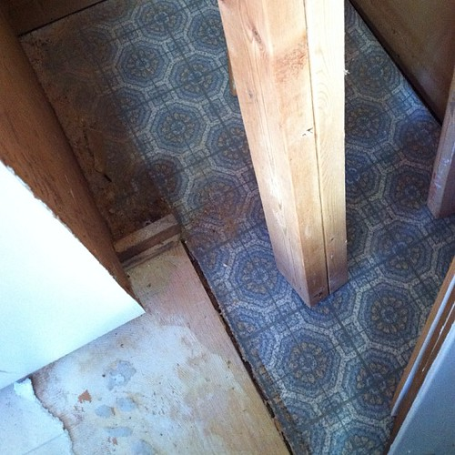 I got a little view of the original floor in my kitchen. Kind of cute all things considered. #renovation #workinprogress