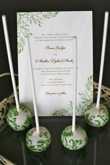 Another image of this beautiful invitation with matching cake pops.