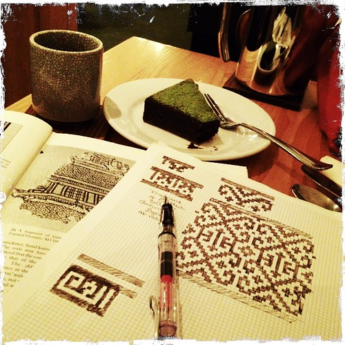 Green tea, matcha dusted brownie, and charting  historical knitting patterns.