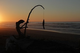 A local Hokitika resident fishing at sunset.