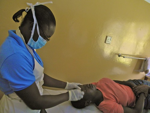 Irene Ballakpa SSL suturing a patients forehead at the Catholic Clinic Oku, Ghana