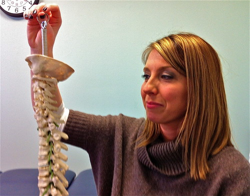physical therapist eases back pain