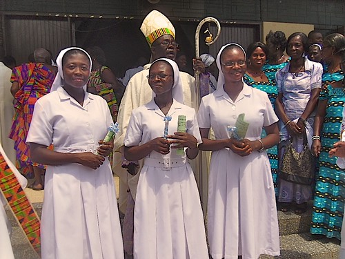 Three newly-professed sisters - Achiaa Akoto Baffour (right), Anna Akua Adomaa (centre), and Lucy Mowen Ayomah (right) - are welcomed into the St Louis family in Ghana