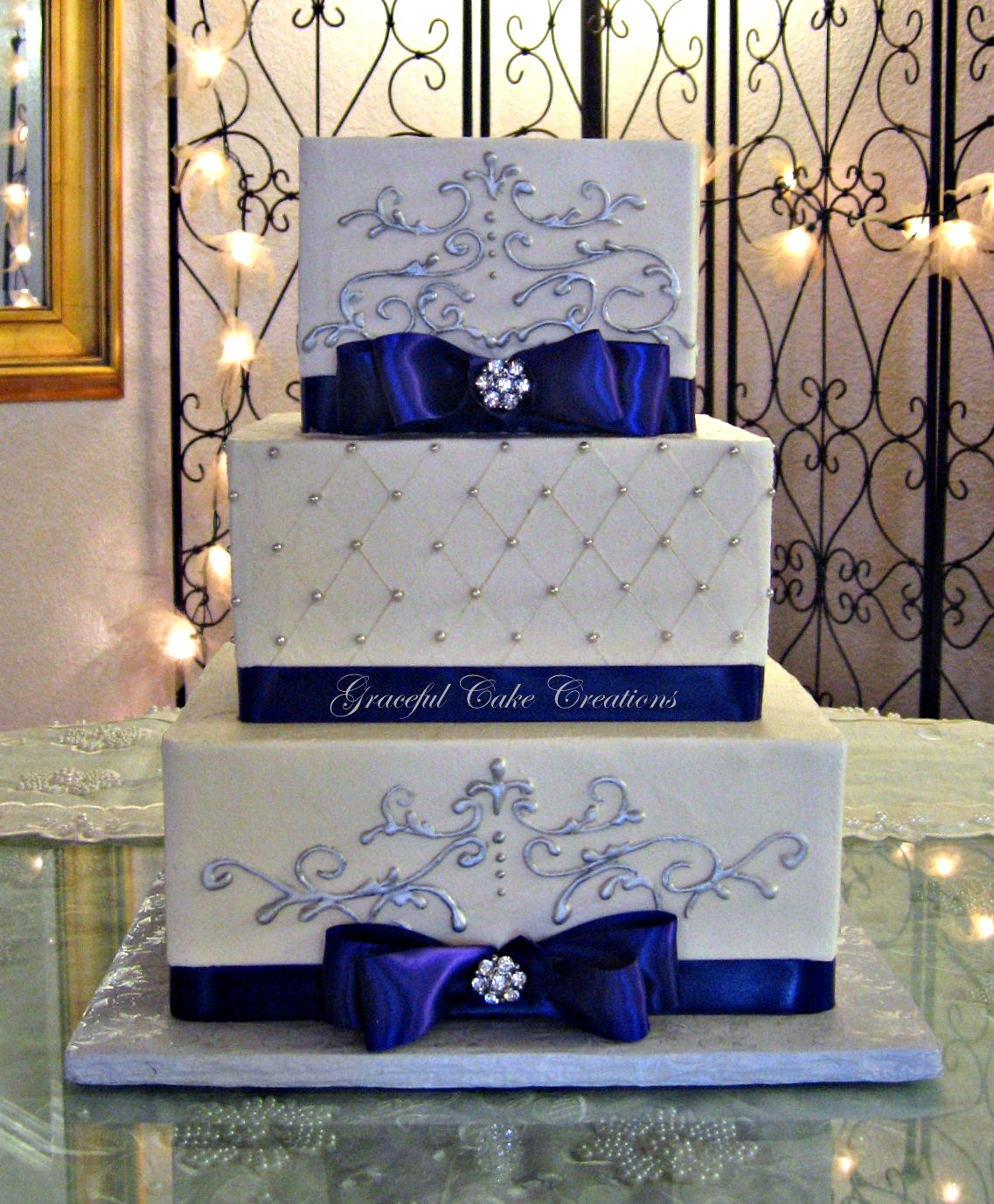 Elegant Square Wedding Cake with Purple Ribbon and Silver