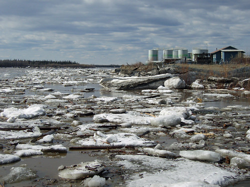 The Yukon River during spring break-up; the tank farm can be seen on the riverbank in the background. Photo by NRCS District Conservationist Joanne Kuykendall.