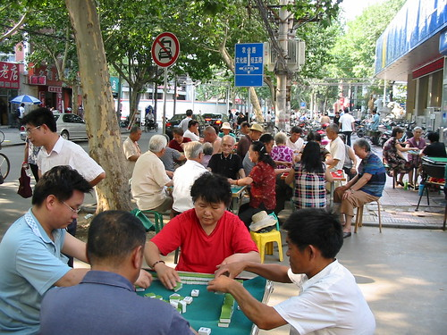 Seniors playing mahjong on the streets of Zhengzhou, China