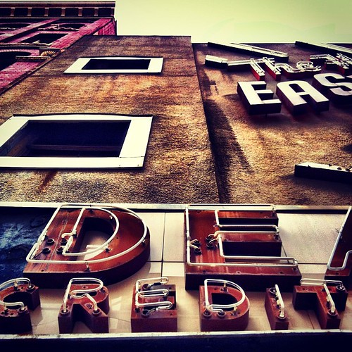 Another shot looking up at the facade and vintage neon signs for Dean's Credit Clothing --