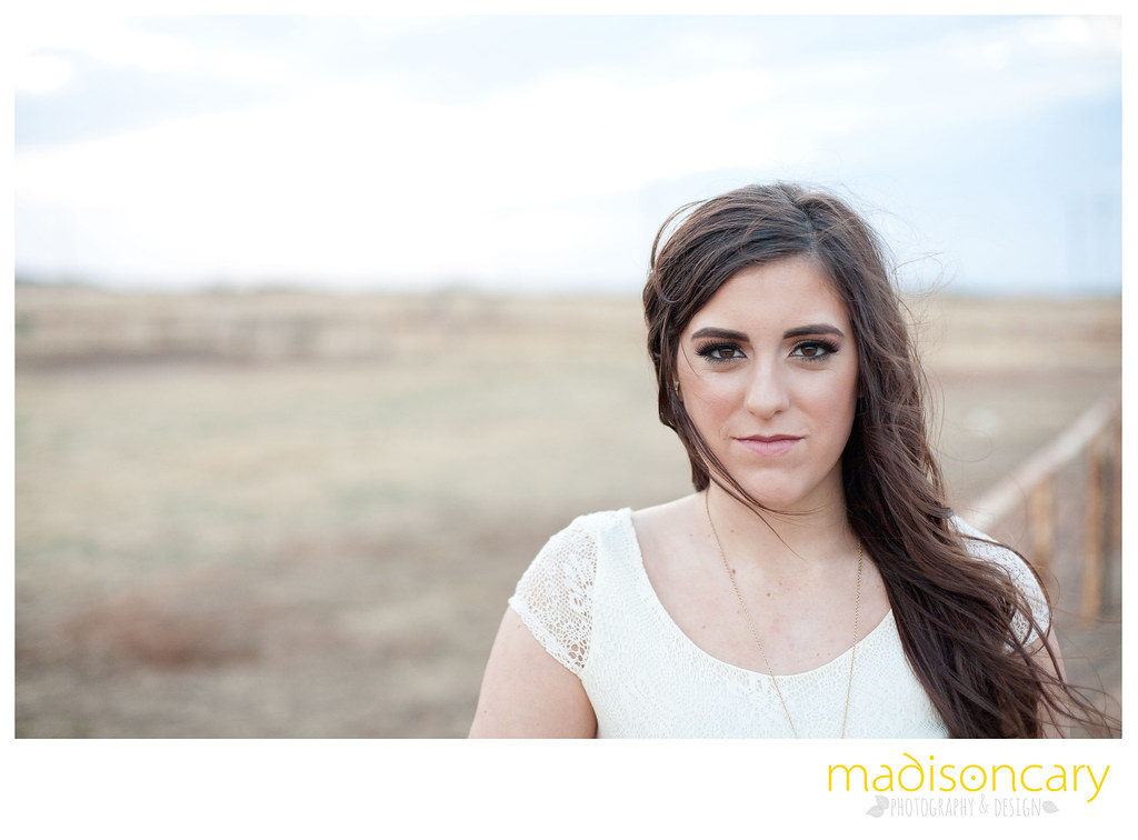 senior girl photos on a ranch field rustic background