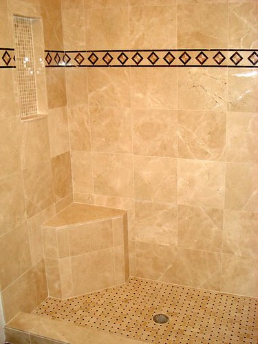 Travertine tile with granite border accents