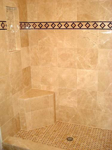 Travertine tile with granite border accents