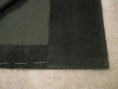 Olive cord jacket front hem inside