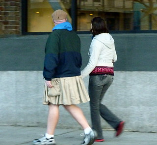 Man in skirt, woman in pants