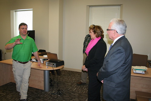 Jeff Campbell of KRHIT explains to Administrator Salerno and State Director Tom Fern how the innovation center is benefitting his health-industry related business. USDA photos.