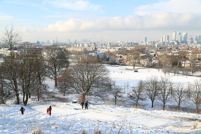 Snowy Greenwich with Canary Wharf and the City behind
