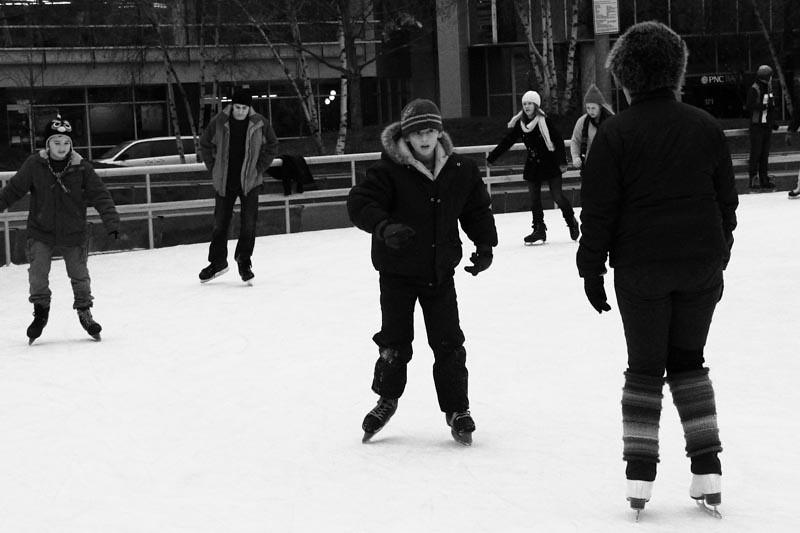 Woman Teaching Boy Ice Skating Rosa Parks Circle Grand Rap