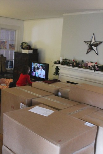 Kitchen Cabinets arrived last night...prize to the person who can guess what Anna is watching!
