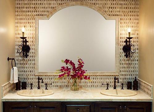 Travertine tile design with chair rail framed mirror