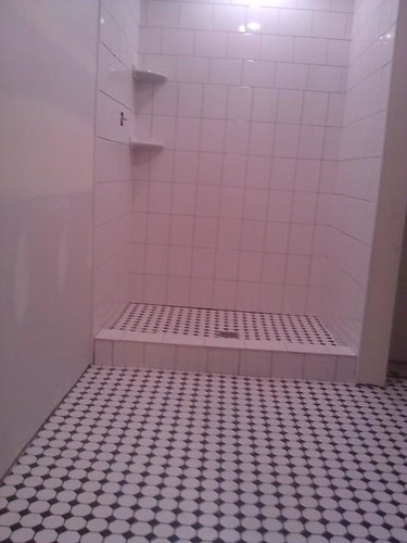 Ceramic tile shower with mosaic floor