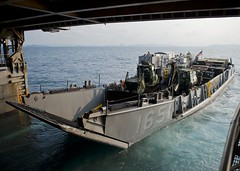 Landing Craft Utility (LCU) 1651, assigned to Naval Beach Unit 7, departs the well deck of the amphibious dock landing ship USS Tortuga (LSD 46) in the Gulf of Thailand Feb. 9 during an off-load evolution ahead of exercise Cobra Gold. (U.S. Navy photo by Mass Communication Specialist 3rd Class Gregory A. Harden II)