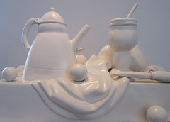 wedding cake(0.0), figurine(0.0), toy(0.0), white(1.0), ceramic(1.0), teapot(1.0), lighting(1.0), porcelain(1.0),