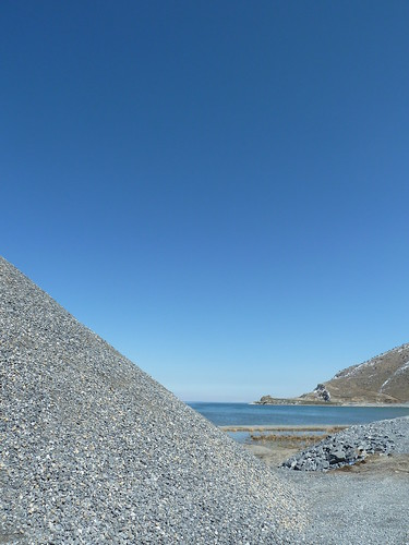 Pile of gravel for road construction on shore of Lake Van by mattkrause1969