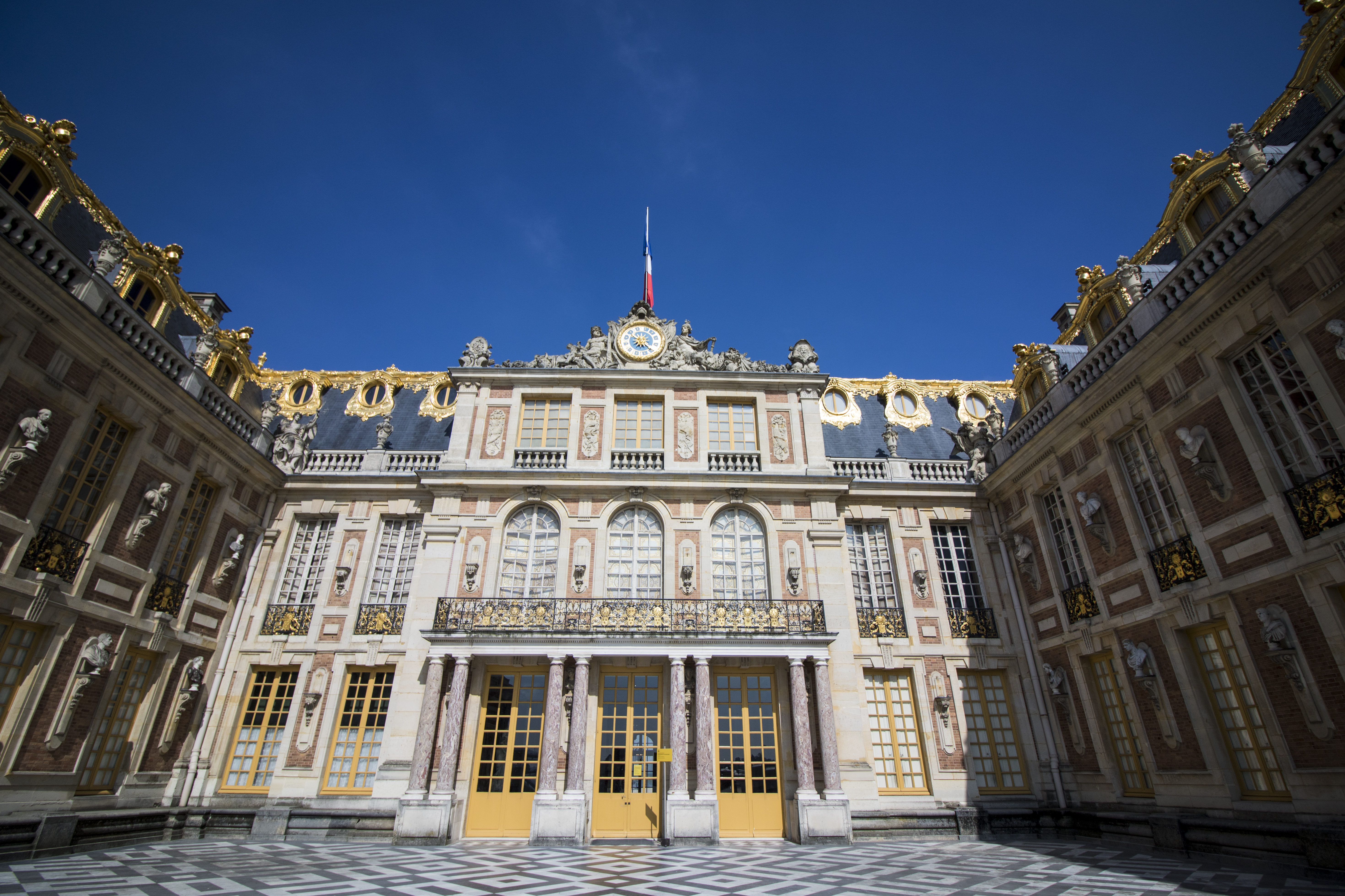 Explore the extensive grounds of Versailles