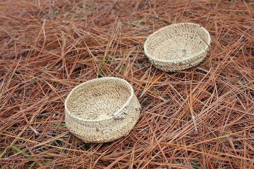 NRCS District Conservationist Andrea Mann, in Oregon, constructs two baskets with longleaf pine needles from Mississippi.