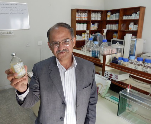 Dr. Muhammad Afzal of the UN Food and Agriculture Organization (FAO) holds a bottle of Foot and Mouth Disease (FMD) vaccine to show it becomes cloudy when it warms and is no longer usable.  USDA helps keep FMD vaccinations cold and viable through its Program for the Progressive Control of Foot and Mouth Disease (FMD) in Pakistan.