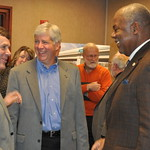 Former League President Woodrow Stanley Talks with Governor Rick Snyder During Transportation Funding Event in Flint