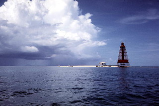 Rain clouds approaching Sand Key Lighthouse