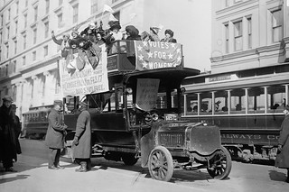 Suffragists on bus in New York City