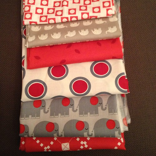 Making fabric combinations - red & grey elephants.