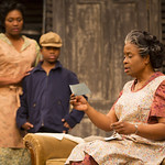 Ashley Everage ('Ruth Younger'), Cory Janvier ('Travis'), and Kimberly Scott ('Lena Younger') in the Huntington Theatre Company's production of Lorraine Hansberry's A RAISIN IN THE SUN. Mar. 8 - Apr. 7, 2013 at Avenue of the Arts / BU Theatre. huntingtontheatre.org. photo: T. Charles Erickson